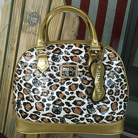 e1e6f867afe Hello Kitty Handbags - Hello Kitty Huge Dome Purse Leopard Print